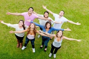 12393950-group-of-people-with-open-arms-outdoors-looking-up